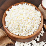 Cottage cheese in rustic wooden bowl Stock Photos