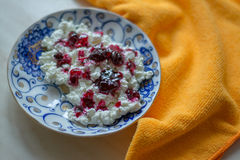 Cottage cheese in rustic wooden plate Royalty Free Stock Photo
