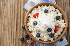 Cottage cheese with sour cream and blueberries with strawberries Royalty Free Stock Photography
