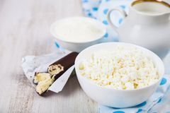 Cottage cheese, sour cream and milk. On a wooden table. Healthy dairy products royalty free stock images