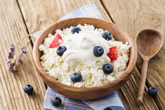 Cottage cheese with sour cream and ripe blueberries Stock Images