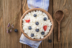 Cottage cheese with sour cream and ripe blueberries Stock Image