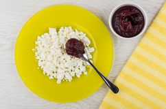 Cottage cheese, spoon with jam in plate, bowl with jam Royalty Free Stock Photography