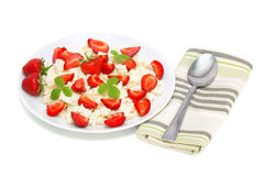 Cottage cheese with strawberries Stock Images