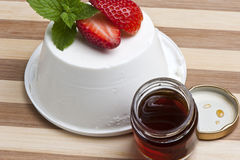 Cottage cheese, strawberries and honey Stock Photo