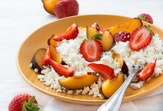 Cottage cheese with strawberries and plums Stock Photos