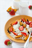Cottage cheese with strawberries and plums Royalty Free Stock Photo
