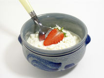 Cottage cheese with a strawberry. Cottage cheese in a blue Alsatian earthenware with a strawberry royalty free stock photos