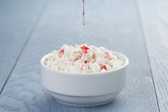 Cottage cheese with strawberry jam in white bowl Royalty Free Stock Image