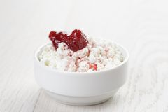 Cottage cheese with strawberry jam in white bowl Stock Images