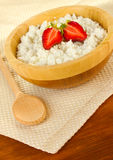 Cottage cheese with strawberry in wooden bowl Stock Photo