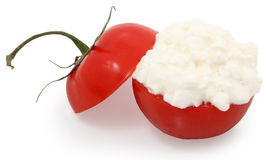 Cottage cheese in a tomato Stock Image