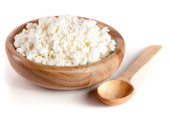 Cottage cheese in a wooden bowl isolated on a white background.  Stock Photo