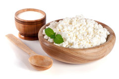 Cottage cheese in a wooden bowl isolated on a white background.  Royalty Free Stock Image