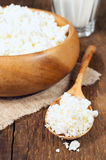 Cottage cheese in a wooden bowl stock photography