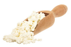 Cottage cheese in a wooden spoon Stock Photos