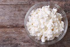 Cottage cheese on wooden table closeup. top view Stock Image