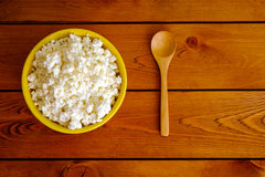 Cottage cheese in the yellow ceramic bowl, top view Royalty Free Stock Images