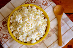 Cottage cheese in the yellow ceramic bowl Royalty Free Stock Image