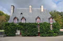 Cottage At Chenonceau Castle. This is the beautiful cottage located in the garden of the famous Chenonceau castle of the loire valley of France. The sky is Stock Photo