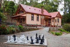 Cottage and chess set Stock Photos