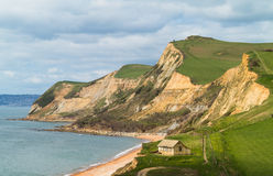 Cottage by cliffs at West Bay Dorset in UK Royalty Free Stock Photo