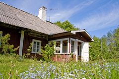 Cottage in countryside Stock Images