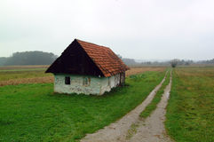 Cottage in countryside. Scenic view of old cottage by track in countryside royalty free stock photos