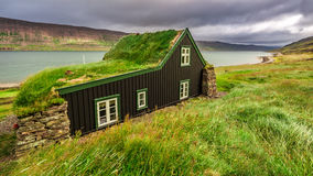 Cottage covered with grass on the roof, Iceland Stock Images