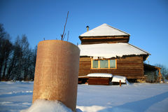 Cottage and covered plant. Winter, Russian house and covered plant at lot Royalty Free Stock Images