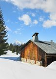 Cottage covered with snow Royalty Free Stock Photos