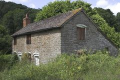 Cottage In Decline. This image of an old stone cottage was captured in the UK Stock Images