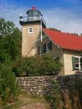 Cottage del faro della contea di Door Fotografia Stock