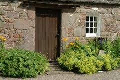 Cottage del vecchio paese, Scozia Immagine Stock