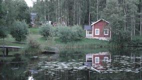Cottage di Lakeside in Finlandia Fotografie Stock