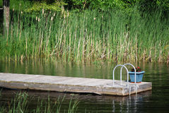 Cottage Dock with a flower pot Royalty Free Stock Images