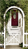 Cottage Door and arbor. A beautiful cottage door at the end of a walk way Stock Photos