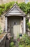 Cottage door with flowers Stock Images