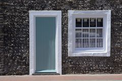 Cottage doorway and window. Rottingdean. England Royalty Free Stock Photos