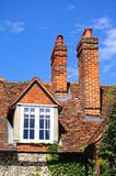 Cottage dormer and chimneys, Hambledon. Royalty Free Stock Photo
