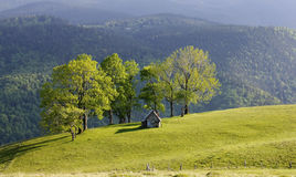 Cottage in dreamy landscape Royalty Free Stock Images
