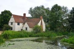 Cottage e fiume dei lotts di Willy Fotografie Stock