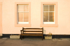 Cottage exterior. Detail of a wooden bench in front of a picturesque fisherman's cottage in the village of Pittenweem in the East Neuk of Fife, Scotland, UK Stock Images
