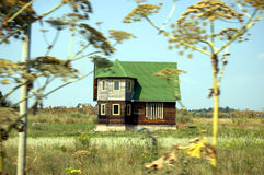 Cottage on a field Royalty Free Stock Photos