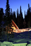 Cottage in-field on a mountain. Royalty Free Stock Photography