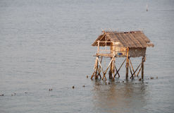 Cottage fishing on the sea Royalty Free Stock Photography