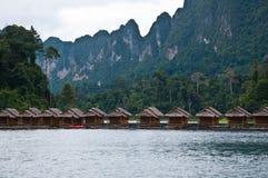 Cottage float on lake stock image