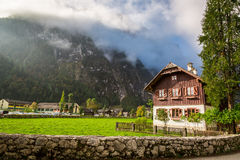 Cottage at the foot of the mountains in the Alps Stock Images