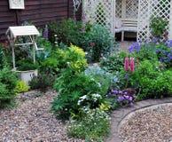 Cottage garden. Pretty cottage garden in the summer time Stock Photos