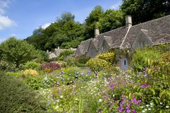 Cottage garden at Bibury. Cotswold cottage in the popular tourist destination of Bibury, Gloucestershire, England Royalty Free Stock Photography